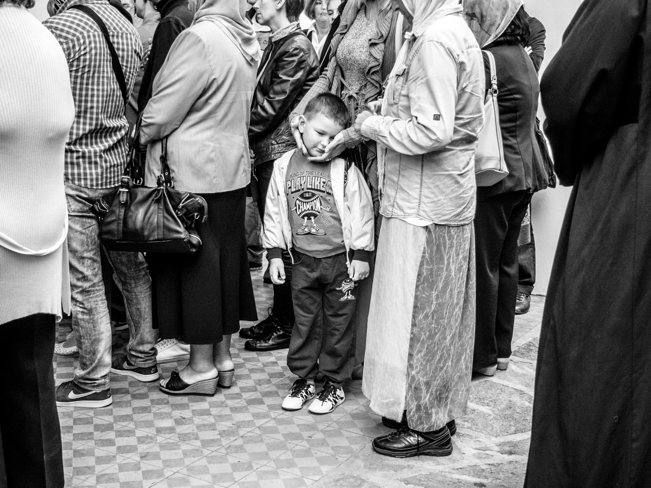 The pilgrims waiting on entrance in front of orthodox Krusedol monastery. Religious tourism is one of the newer forms of tourism in Serbia with a tendency to develop. In the last ten years especially, it has been triggered by a general recovery of practicing religious customs and Christian beliefs. Fruska Gora, Serbia 2016