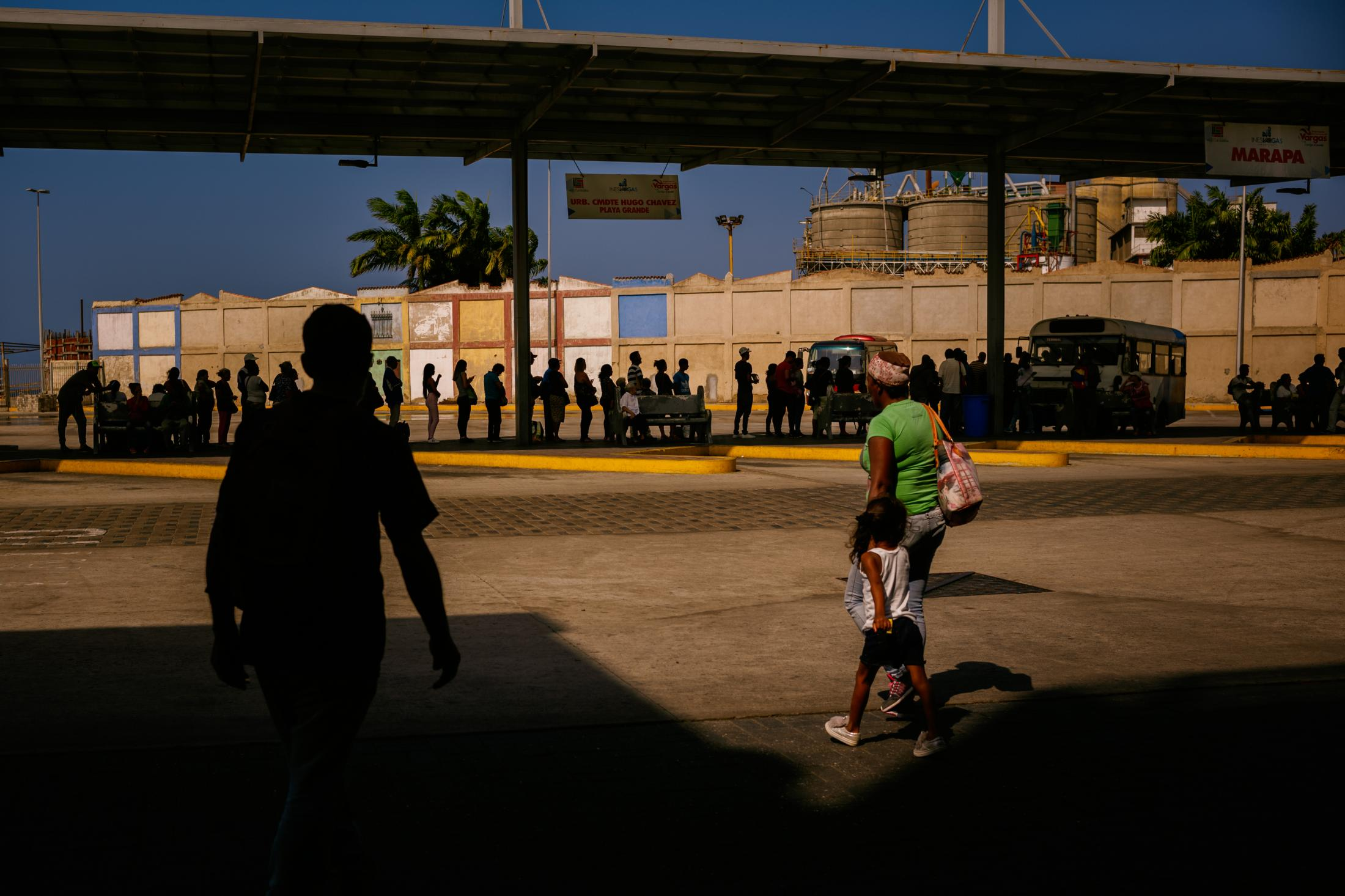 People queue waiting for the bus. Public transport ́s quality has decreased significantly in the past years with Nicholas Maduro ́ government. People got used to long queues and hours of waiting to be able to commute to work or back home. Catia la Mar, Caracas, Venezuela. 28th February 2019.