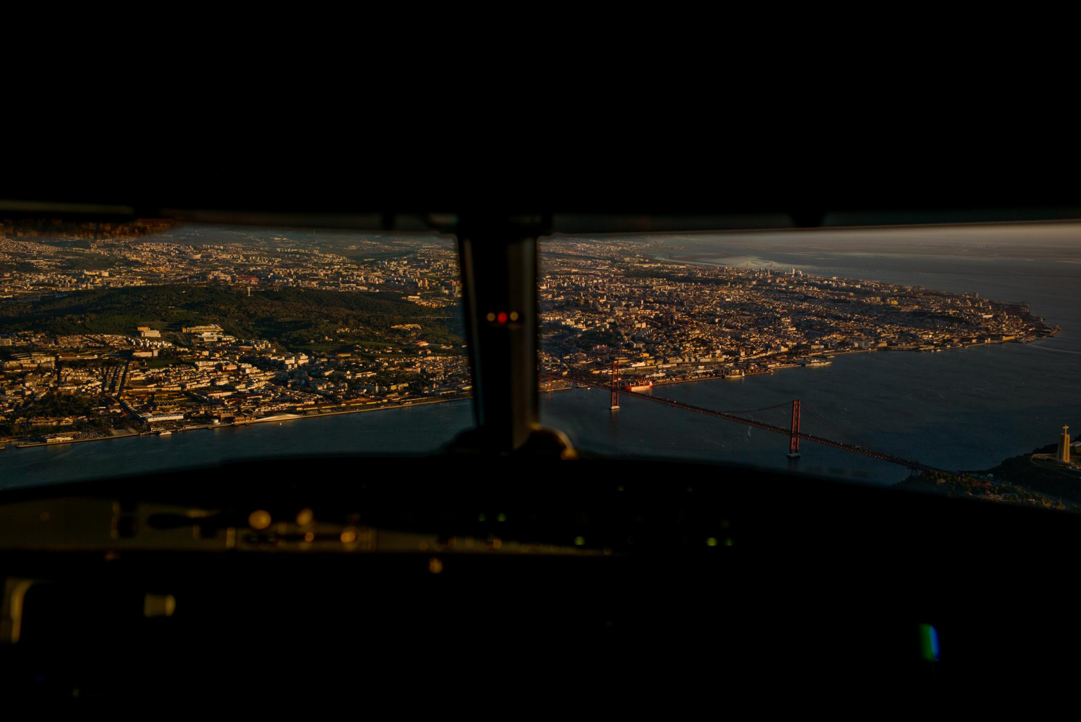 "The view from the cockpit of a plane landing in Lisbon, the Portuguese capital. 16th December 2017. Lisbon is where this reversed migration coming ""back"" to the Portuguese island of Madeira flies to first. They fly from Caracas to Lisbon where they transfer to Madeira Island."