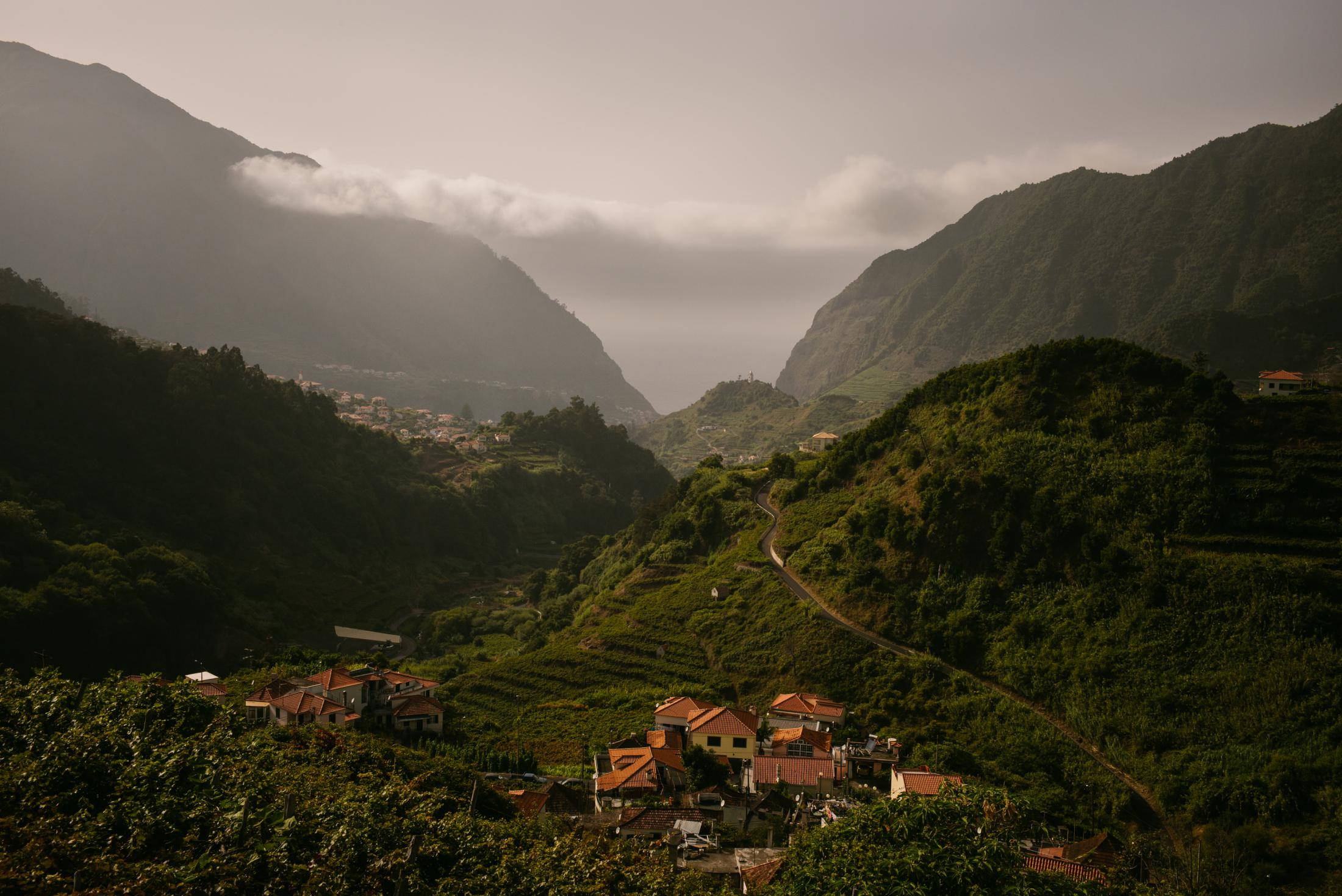 A view of the village of São Vicente in northern Madeira. Madeira, Portugal. 12th August 2017. For a long time, Portugal, which includes the island, was considered an emigration country. Especially during the dictatorship between 1926 and 1974, many residents left the country - often in the direction of Venezuela. Because of the oil boom, it was one of the richest countries in South America at the time. Today about 500,000 people of Portuguese descent live there, most of them from Madeira. Especially the rural regions of the island were almost deserted for a long time due to the emigration. It's different today: Between 2017 and 2019, between 5,000 and 10,000 Portuguese returned to their home country due to the Venezuelan crisis. Anyone who could buy a house near the main town of Funchal in better times will return there. For others, parents or relatives are the first point of contact.