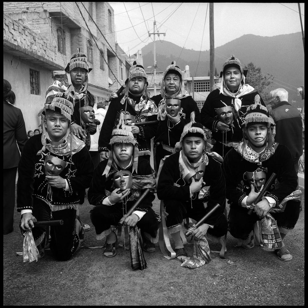 "A group of Yalaltec descendants based in Mexico city after they performed the ""Negritos"" traditional dance. At the Rosario virgin celebration. Cuautepec, Mexico city. October 2018."