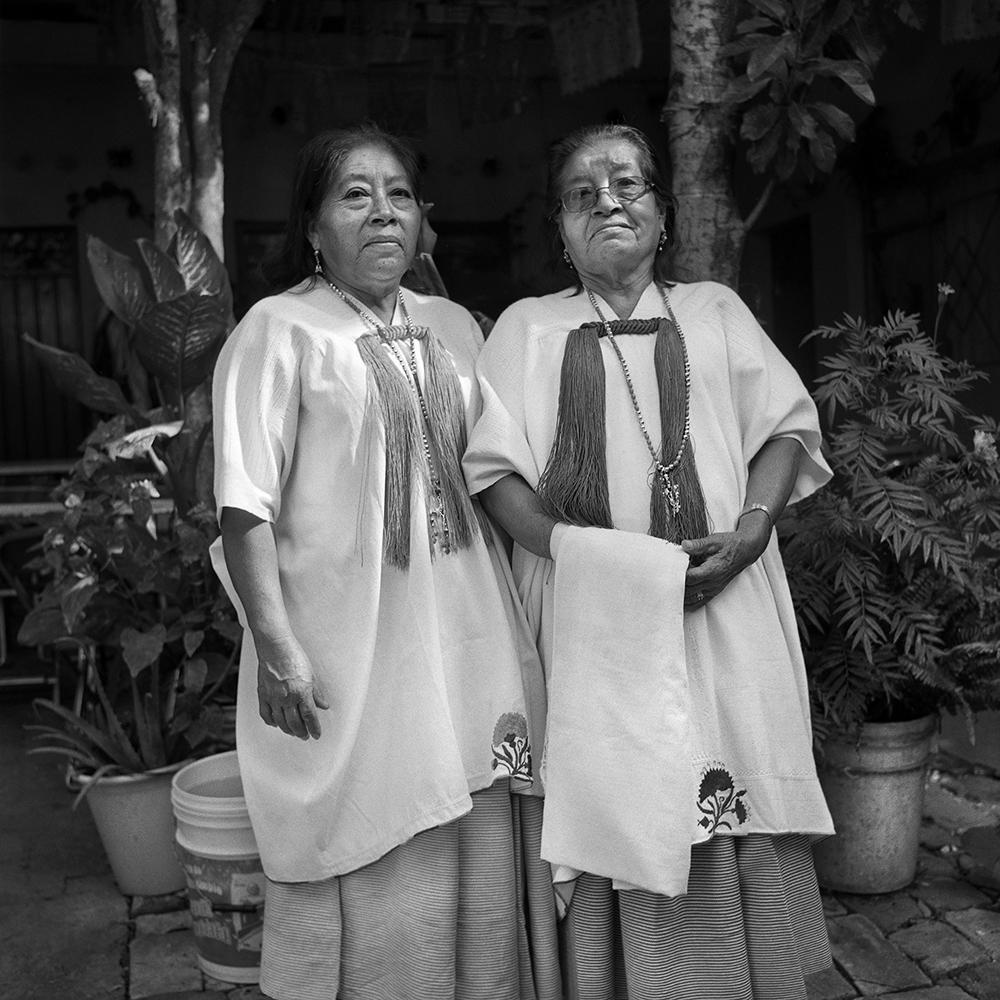 Hermanas Laurentina and Teresa Sixto. There is no celebration where they don't go to help to cook. Comunitary kitchen implies at least 5 days of service. They are authority voices to everyone helping, no one says no to them. Oaxaca city, December 2018.