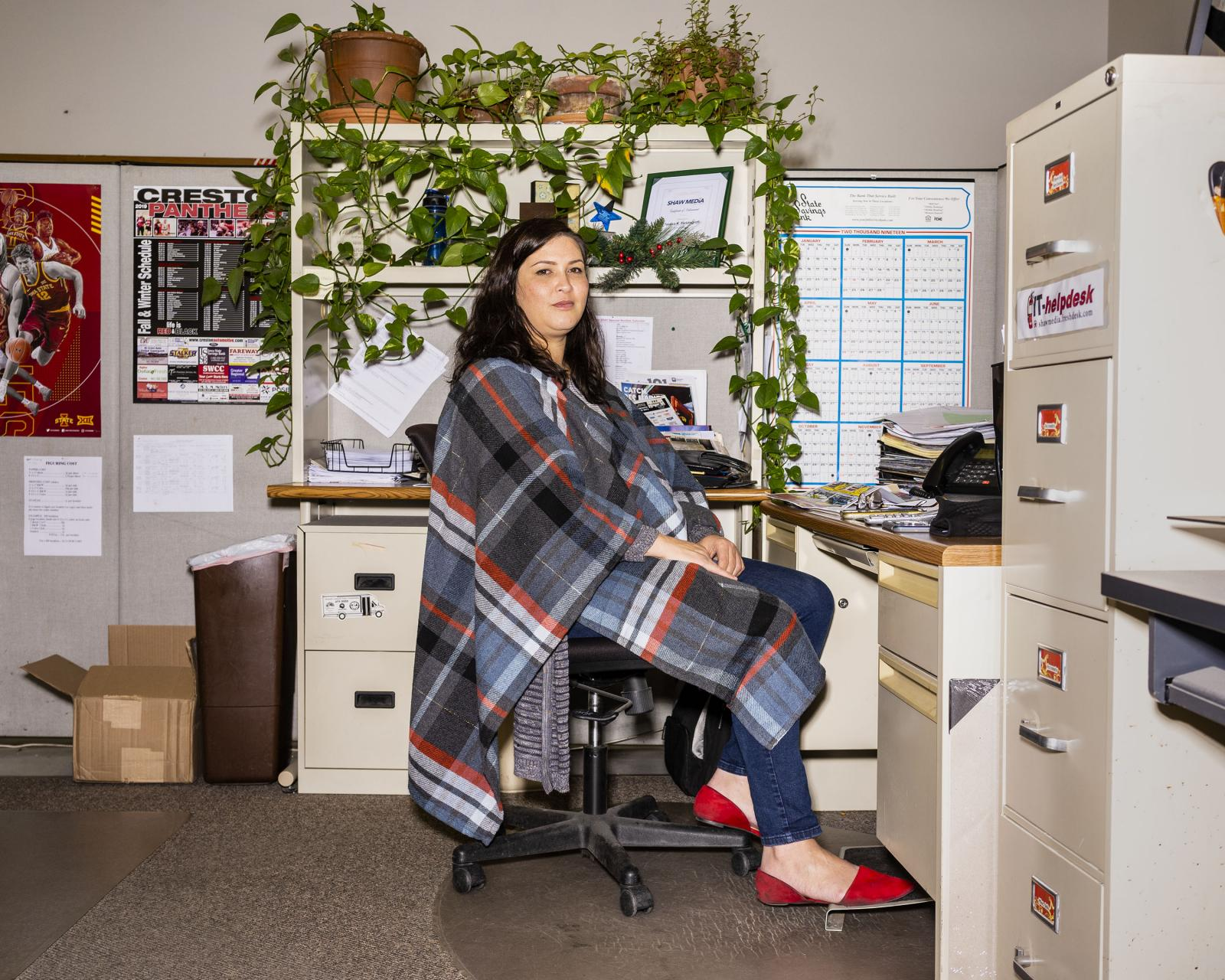 Managing Editor Sarah Scull sits in the office of the Creston News Advertiser in Creston, Iowa on Friday, December 13, 2019. KC McGinnis for La Croix L'Hebdo
