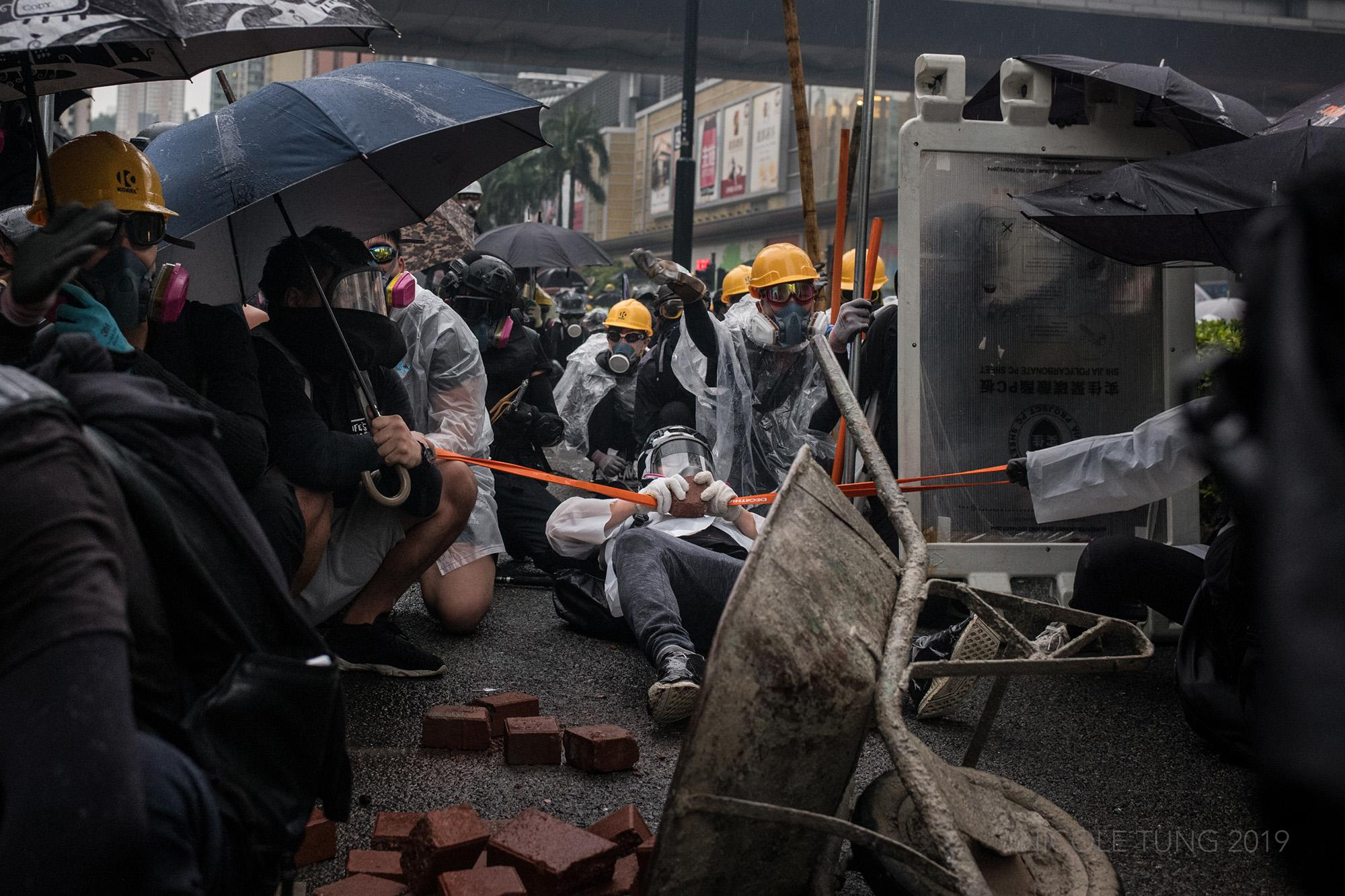 Protestors launch a brick from a large sling shot as they face off with riot police in Hong Kong, S.A.R. following the end of an anti-government rally. August 2019.