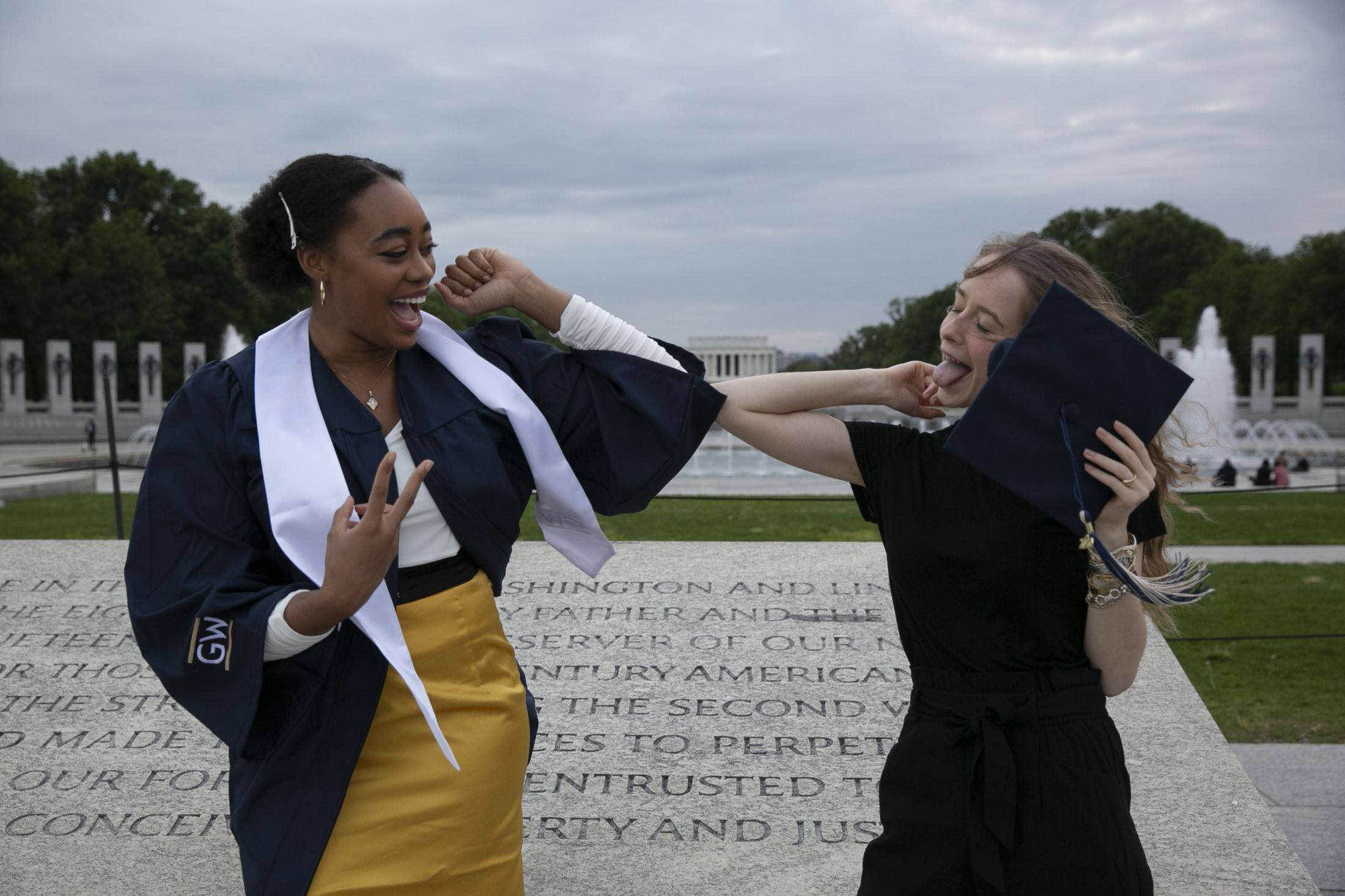 I met two new graduates, Geena and Kate, from George Washington University during a sunset walk near the Lincoln Memorial Reflecting Pool. There was a shortage of graduation gowns so they had to share a gown for photoshoots. This year, the pandemic made the ceremony virtual, sadly breaking the traditions of having the ceremony at the National Mall. It didn't stop them from celebrating the joy of graduation from college with their friends and classmates.