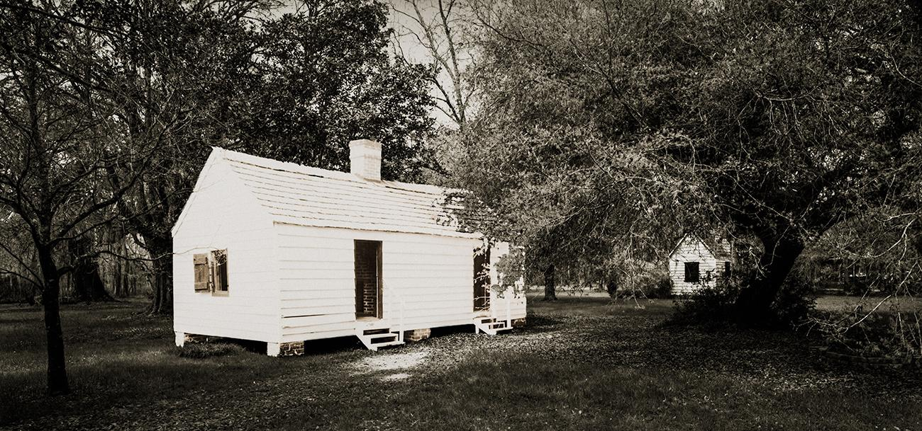 "Slave Dwelling No.18: Magnolia Plantation, South Carolina Silver gelatin photograph handprinted from an 8x16"" film negative. The slave cabin was painted with bleach and toners to visually communicate the sense of the structures fading away. To purchase a limited edition photograph click"