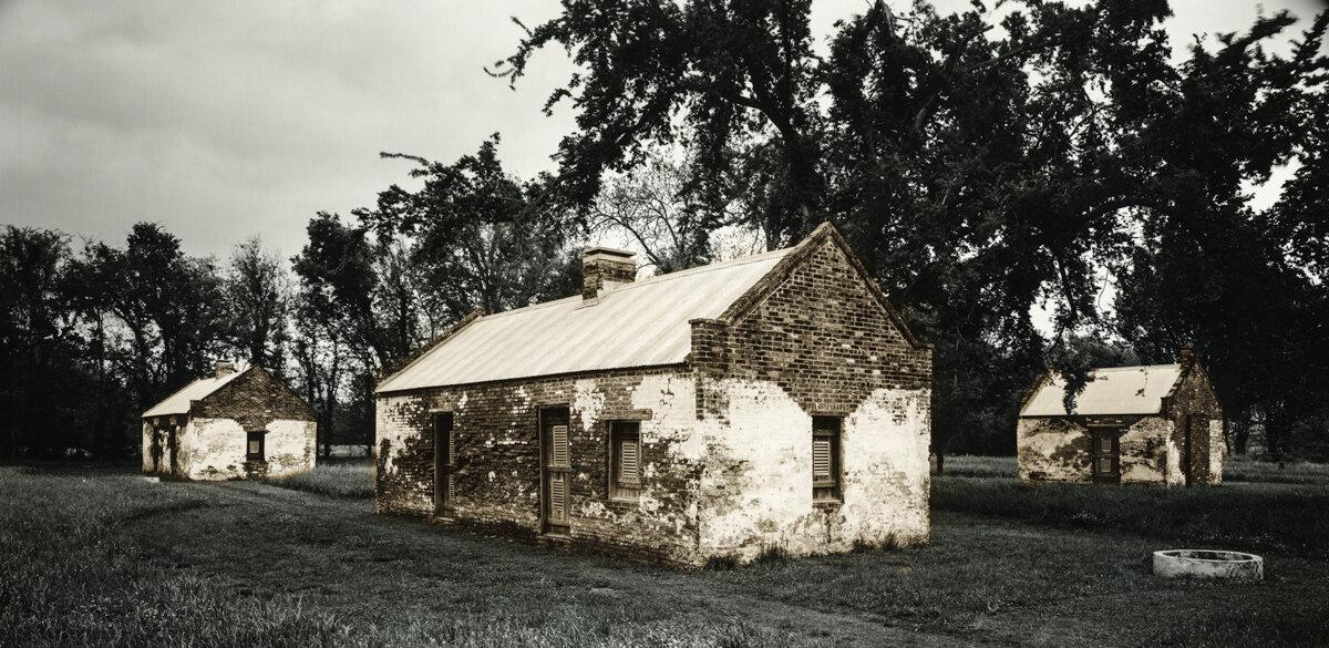 "Slave Dwelling No.23: Magnolia Plantation, Louisiana Silver gelatin photograph handprinted from an 8x16"" film negative. The slave cabin was painted with bleach and toners to visually communicate the sense of the structures fading away. To purchase a limited edition photograph click"