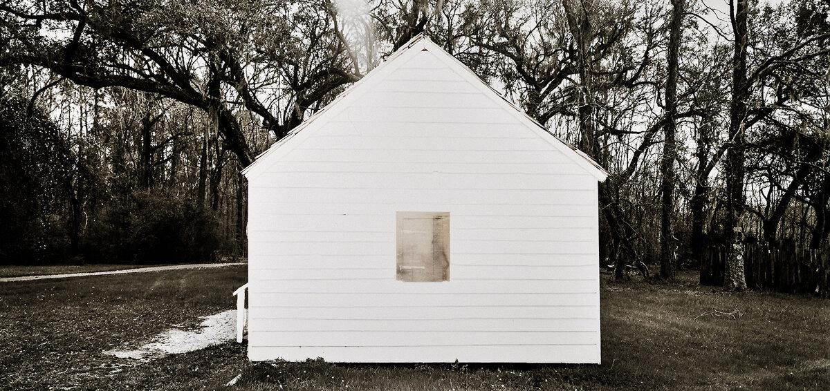 "Slave Dwelling No.15: Magnolia Plantation, South Carolina Silver gelatin photograph handprinted from an 8x16"" film negative. The slave cabin was painted with bleach and toners to visually communicate the sense of the structures fading away. To purchase a limited edition photograph click"