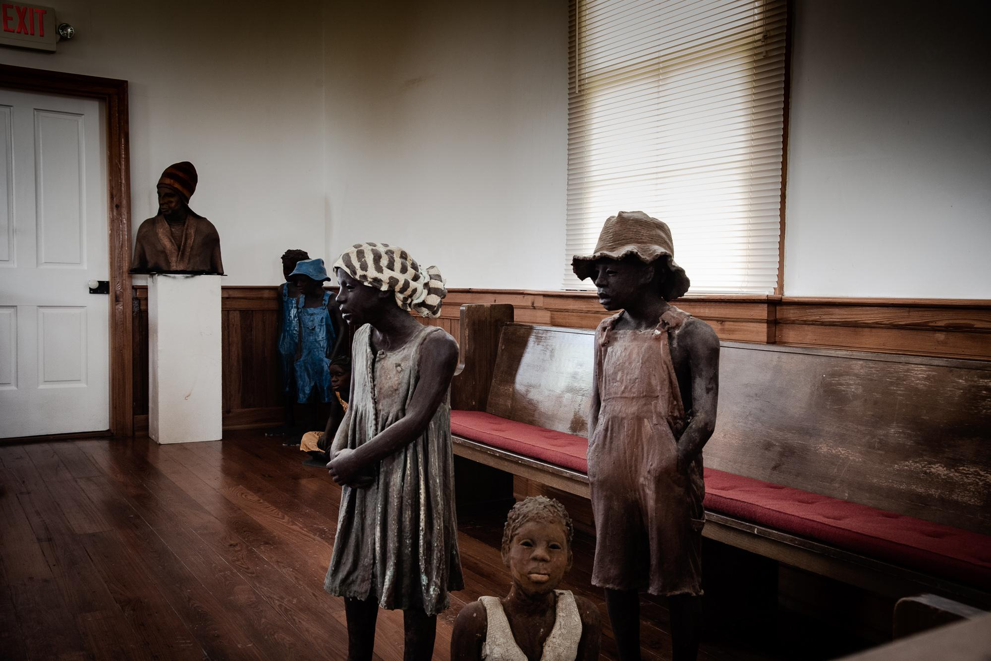 Statues, Whitney Plantation, Louisiana Created by Woodrow Nash, the life-sized clay statues are based on true stories of children enslaved on the plantation. Whitney Plantation was purchased by New Orleans trial attorney John Cummings in the 1990s and he set out to create the first museum solely focusing on the issue of slavery. Sengelese scholar Ibrahima Seck co-founded the museum and provided extensive research.
