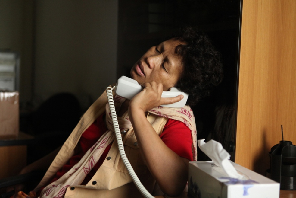 Aimee, from Madagascar has been living in Lebanon for 14 years. After working as a domestic maid in Beirut, she decided to help girls who were being abused/ trying to run away from their employers. Here, she receives a phone call from a girl regarding migration papers.
