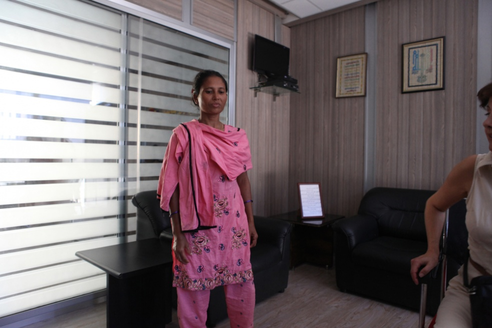 """Manjo, from Bangladesh, stands in a maids recruitment agency office in Beirut, Lebanon. Before she entered the room to stand infront of a client, the recruiter said, """"you don't want this one, she's useless. She doesn't know anything. She doesn't speak Arabic or English"""". She was forced to remove her head scarf several times,infront of this possible client."""