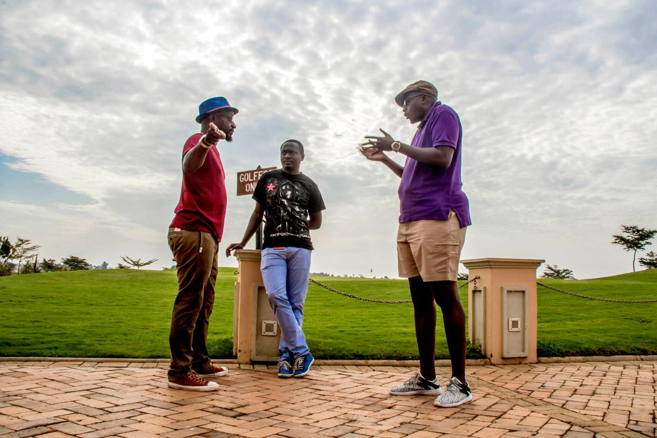 Gaetano Kagwa and Marcus Kwikiriza engage in a heated conversation with the show producer and director -Danze Edwin (center), about how they should begin the segment of the show at Kigo.