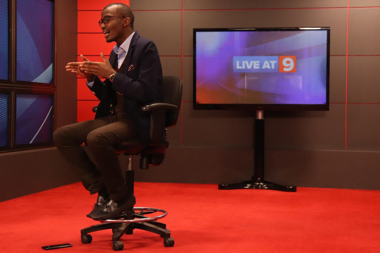 "Senior Investigative journalist -Raymond Mujuni gestures emphatically during a segment about the stations ""Fake News"" campaign during a recording."