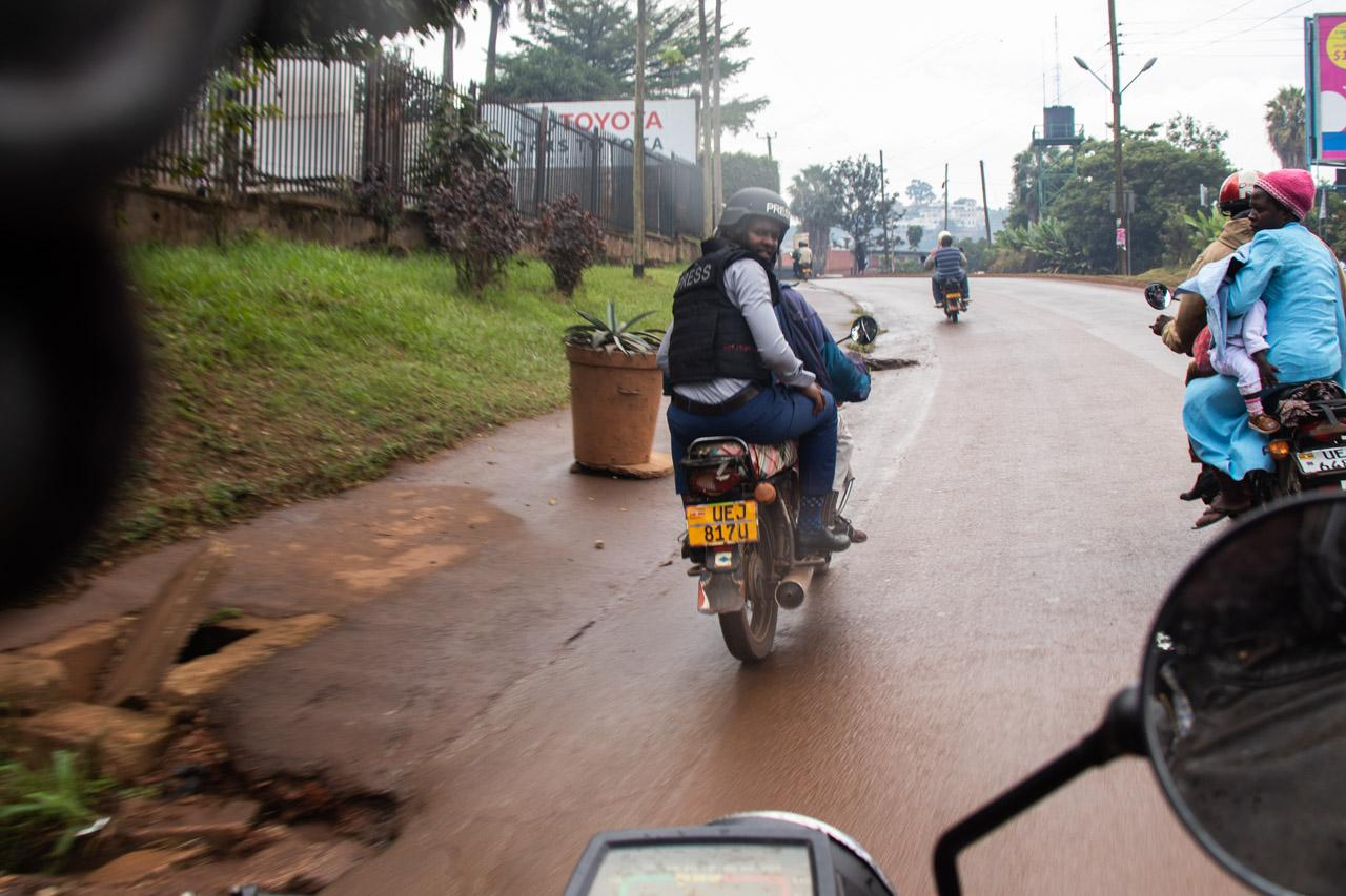 Senior News Reporter -Canary Mugume, returning to the NBS offices in Kamwokya by motorcycle taxi, after reporting on the 'Social Media Tax' protest in Kampala.
