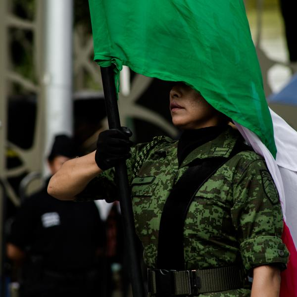 2017. A soldier leads the parade of Cinco de Mayo holding the Mexican flag. The event holds the presence of the Mexican army since they commemorate an important battle in the country.