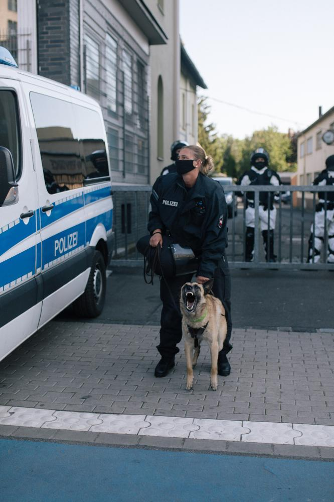 A police dog barks at protesters. June 23rd