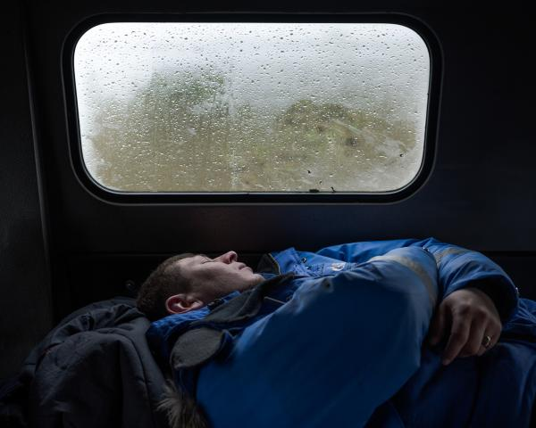 A rescuer sleepiing in the car. The people had to work in 2 shifts. Usually they slept around 3-5 hours a day. June 2020.© Stoyan Vassev