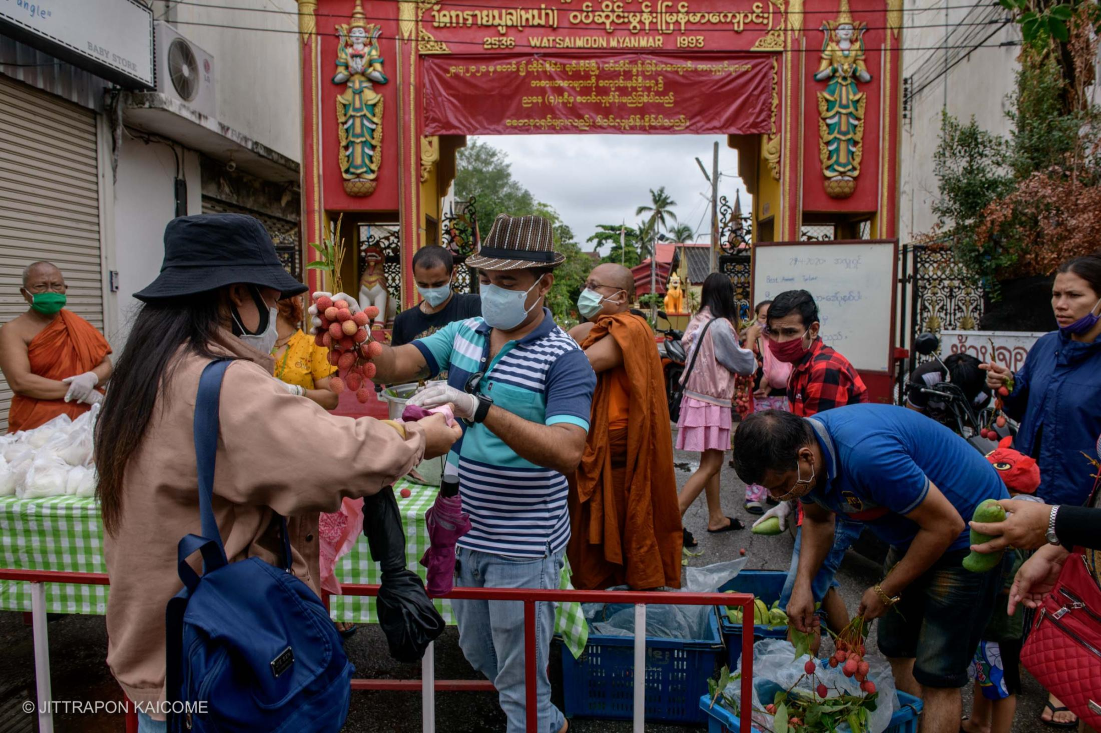 Covid-19 affected Burmese migrants who come to receive food handouts organized by the multi-ethnic brotherhood lead by Johny Adhikari at Wat Sai Moon Temple, a Burmese temple built during the time that Chiang Mai was under Burmese rule. - Chiang Mai, Thailand in April 2020.
