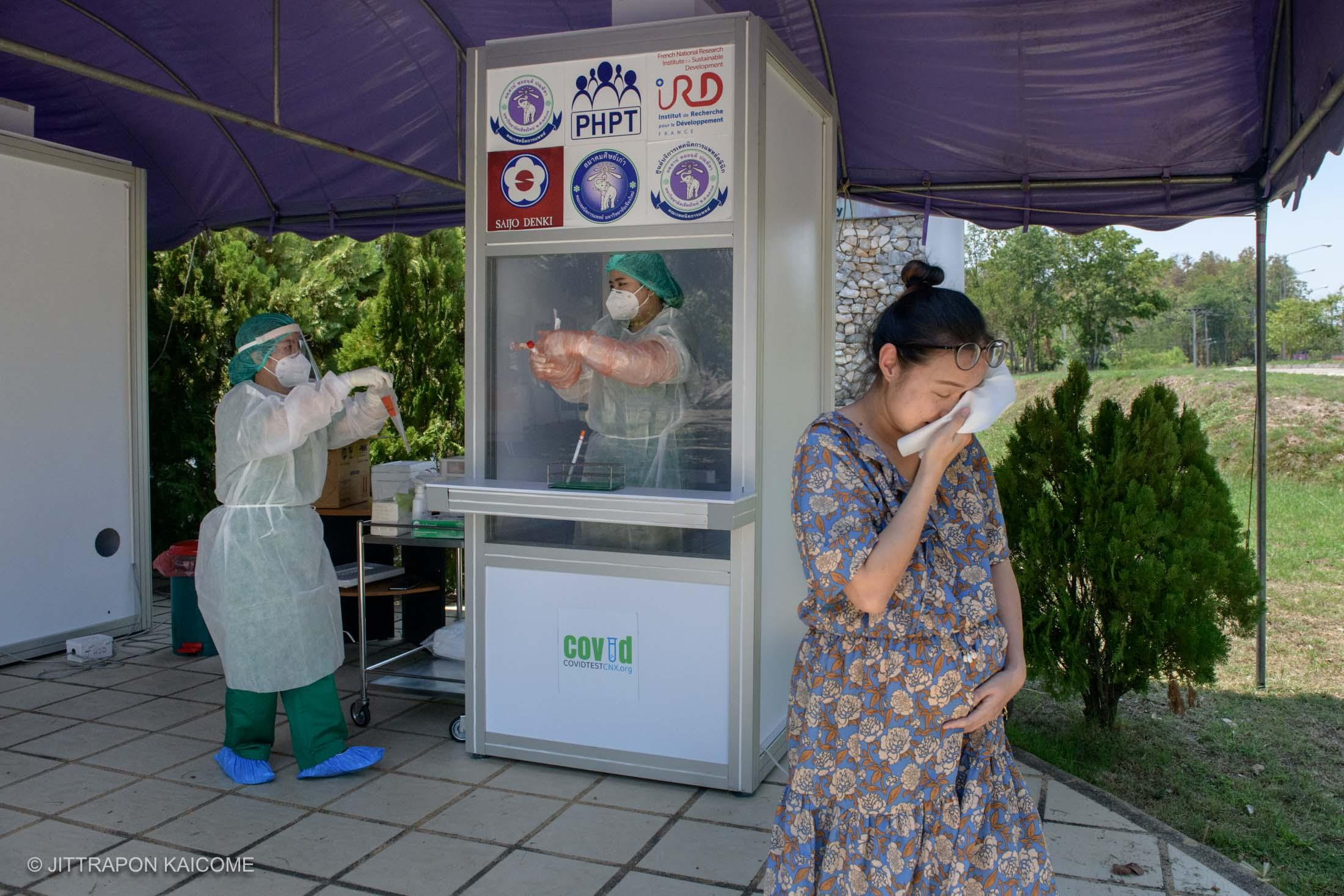 12.58 PM - Chiang Mai medical staffs are collecting Covid-19 samples testing from patients who registered in Lamphun back to the lab in Chiang Mai. May 07, 2020.