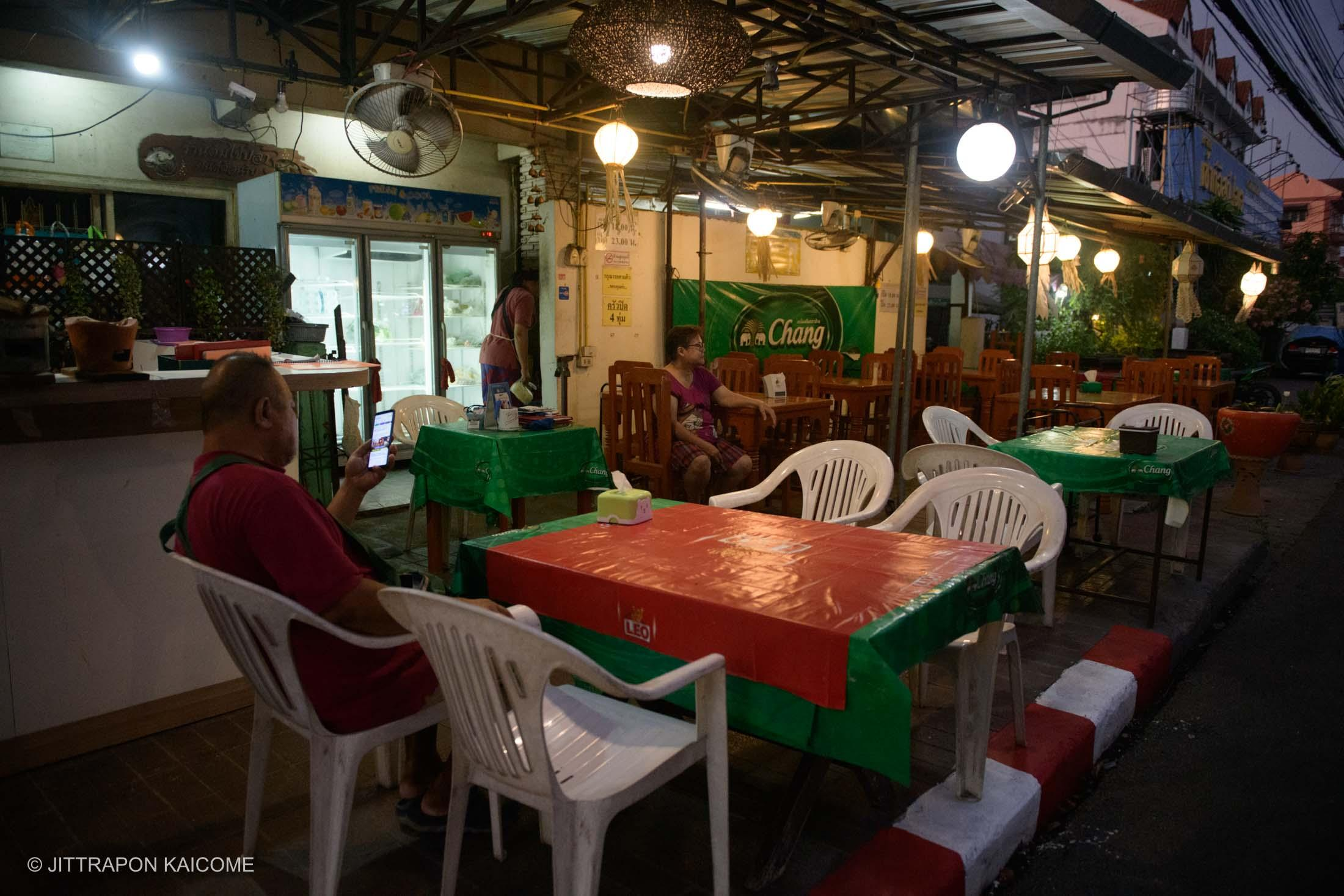 07.08 PM - No customers at the restaurant on the sidewalk at the square of Chiang Mai old town due to the Coronavirus outbreak. Chiang Mai, Thailand in May 16, 2020.
