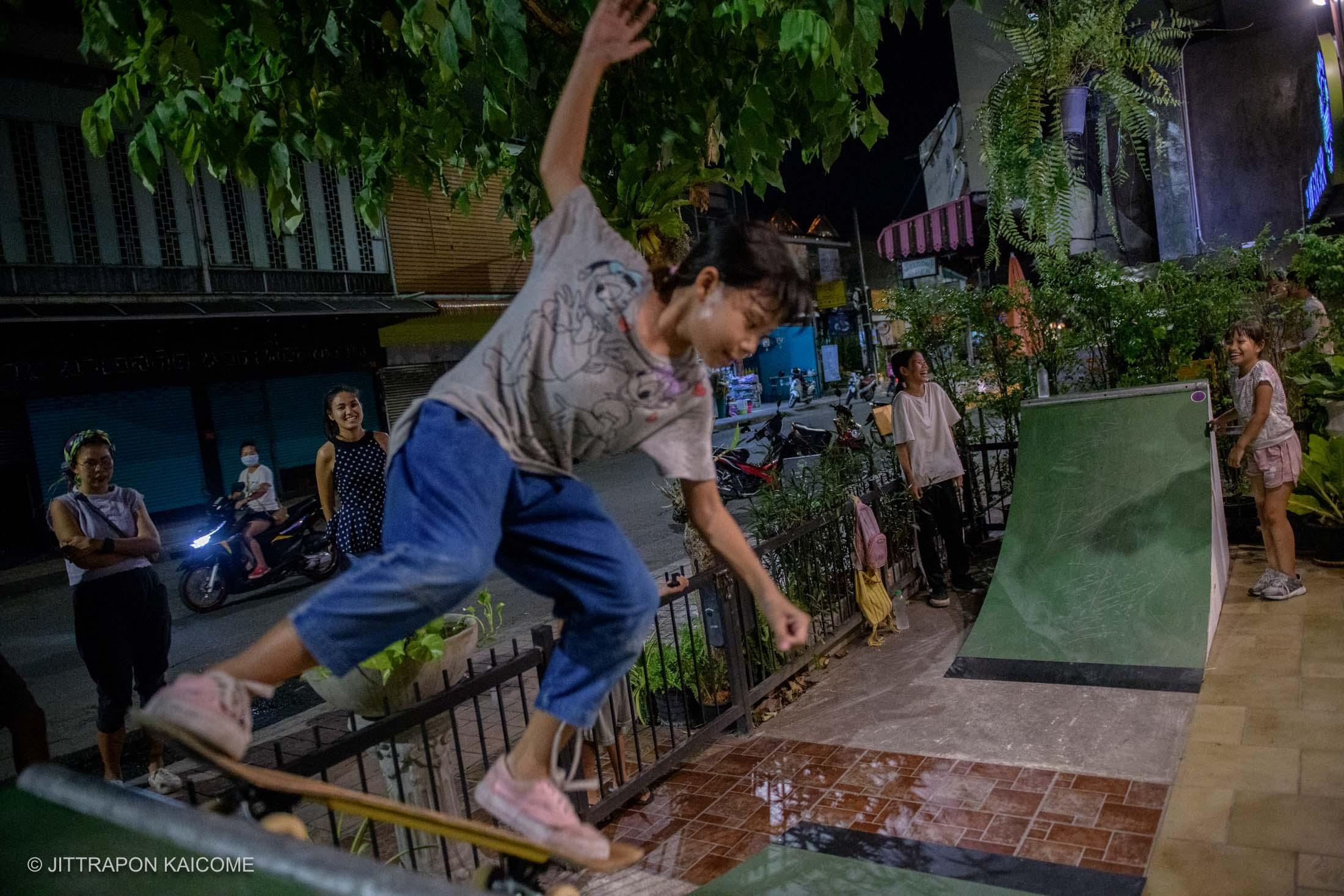 08.05 PM - The Young talented female skaters are practicing skateboarding in front of their family burger restaurant amid to the closure of businesses in the area inside the center of Chiang Mai old town due to Coronavirus. Which is also affecting the school closure and many skateboarding competitions are canceled. Chiang Mai, Thailand in March 16, 2020.