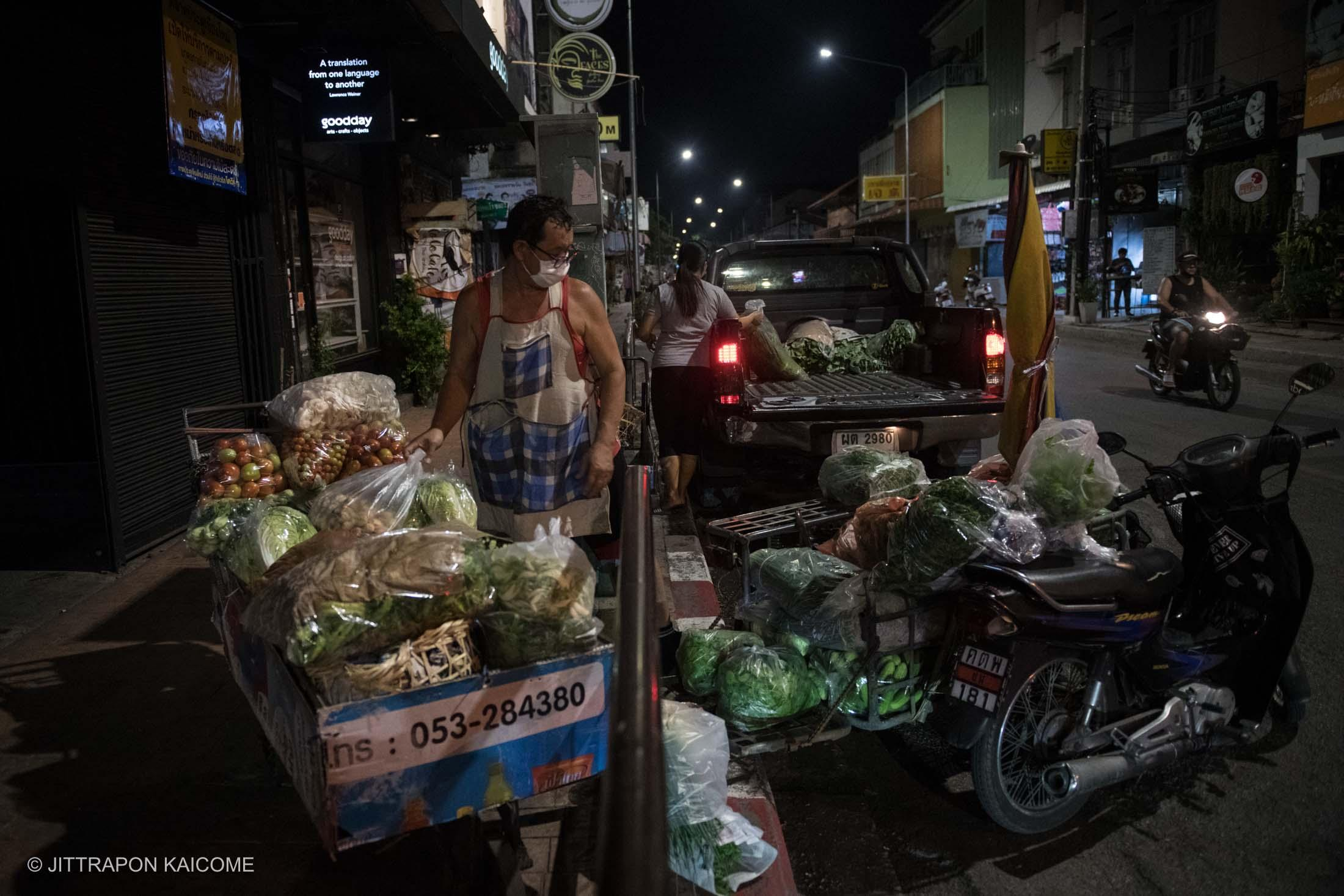 08.12 PM - Fresh food vendors are organizing vegetables into the market in the center of Chiang Mai old town amid the coronavirus outbreak is lowing people's purchasing power. People are buying fewer products from the market. Which many left unsold in time before the vegetable becomes rotten. Chiang Mai, Thailand in May 16, 2020.