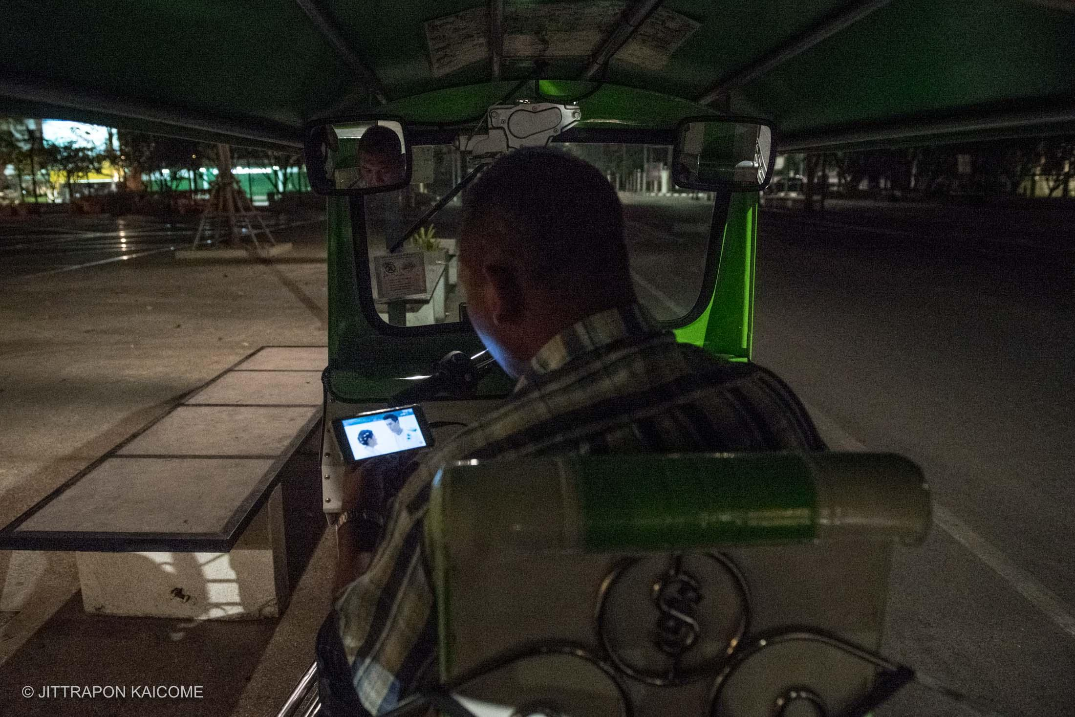 07.42 PM - Empty streets at tourist hot spot, a Tuk Tuk driver is waiting for customers. If he is lucky, he could earn some money for the day, Chiang Mai, Thailand in March 23, 2020.