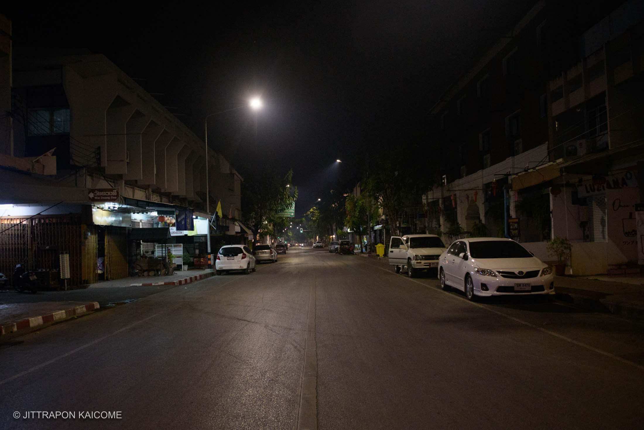 08.13 PM - Empty streets at the center of Chiang Mai old town near the Three King Monument. Chiang Mai, Thailand in March 24, 2020.