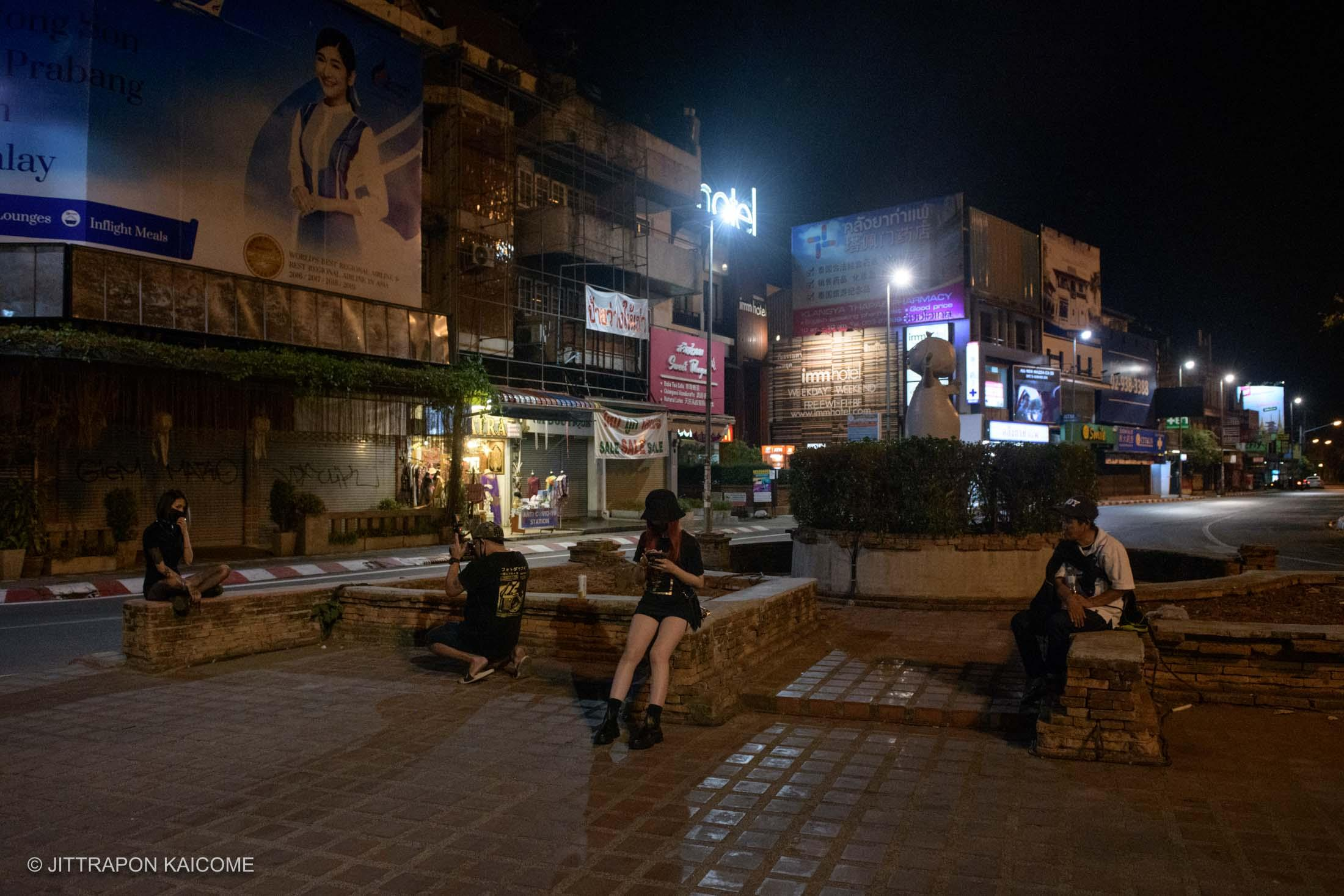 09.45 PM - Young teenagers are out for a photo shoot with the unusual scenario of the empty streets due to the Coronavirus outbreak in the are of the Chiang Mai old town. Chiang Mai, Thailand in March 24, 2020.