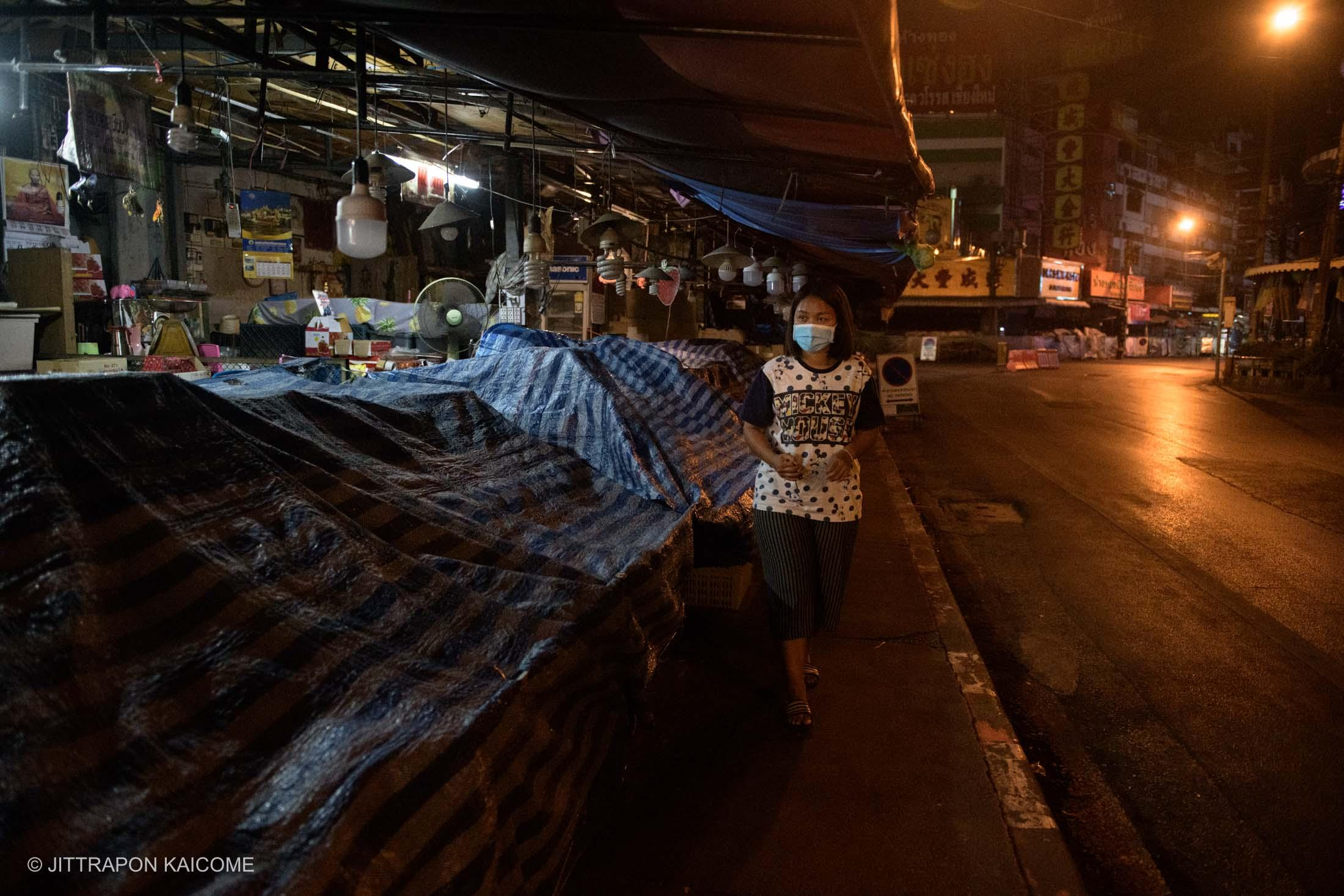 08.23 PM - Warorot Market, the well-recognized old market, a site to buy and sell local food, fruits, clothes and a wide variety of products is open from early till late night. Before the outbreak of the virus, vendors were able to earn a decent income. Chiang Mai, Thailand in March 25, 2020.