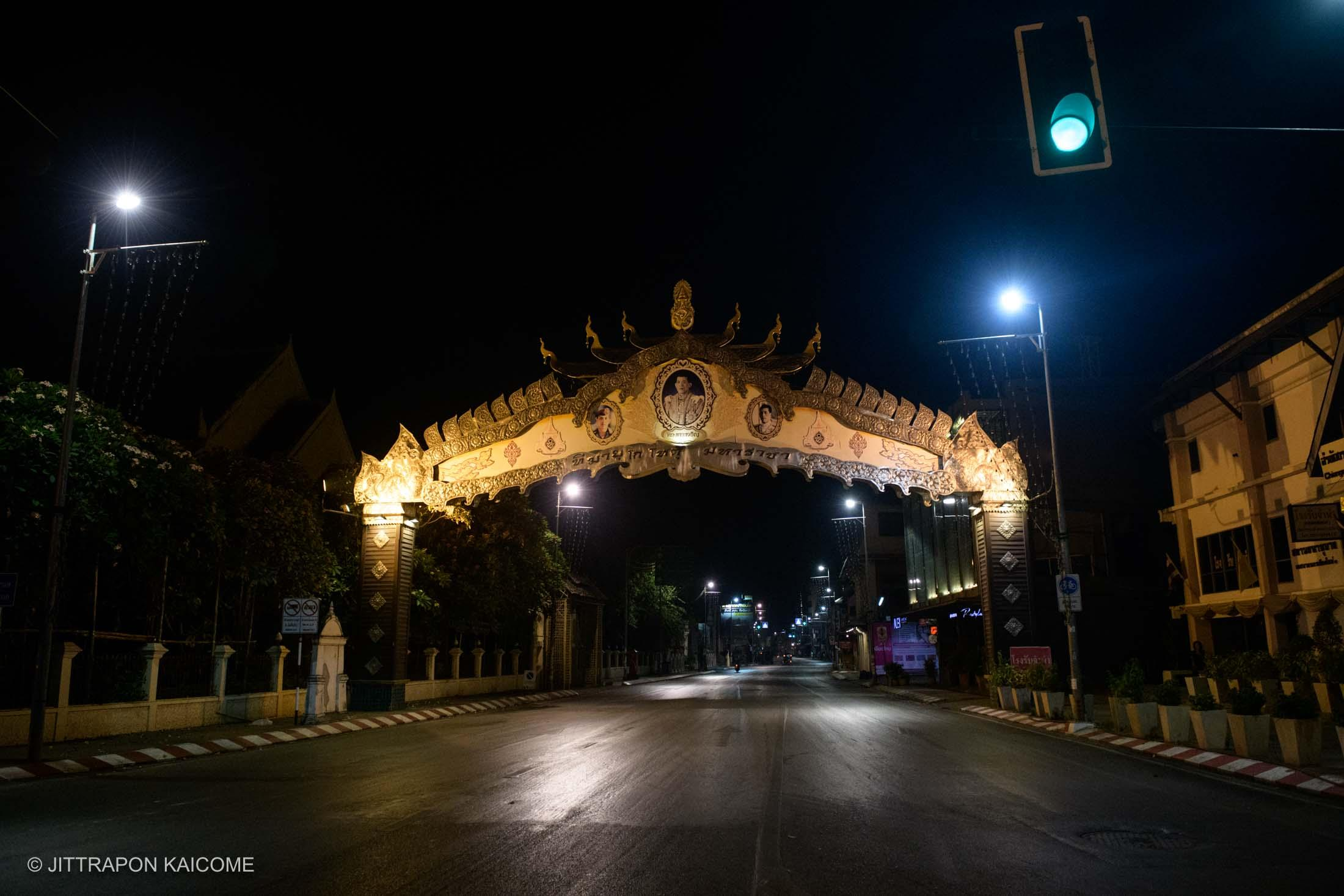 10.58 PM - Empty street of the Tha Phae Road, the business venues, and tourist hot spot which joints between Nawarat bridge and Tha Phae Gate. Chiang Mai, Thailand on March 25, 2020.