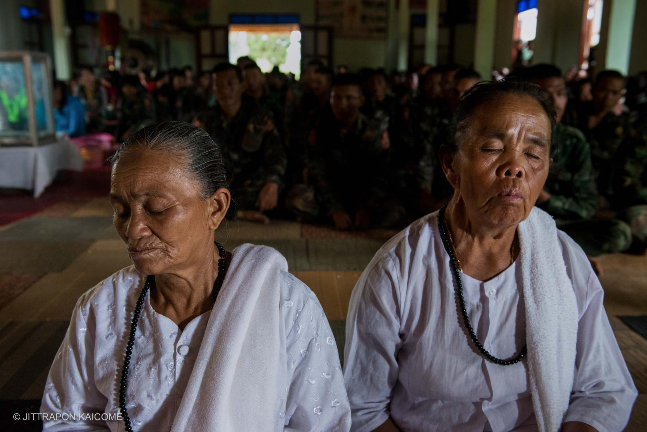 Senior Shan women meditate at the temple after chanting in the morning on a Buddhist holy day. At Loi Kaw Wan, Thailand-Myanmar border.