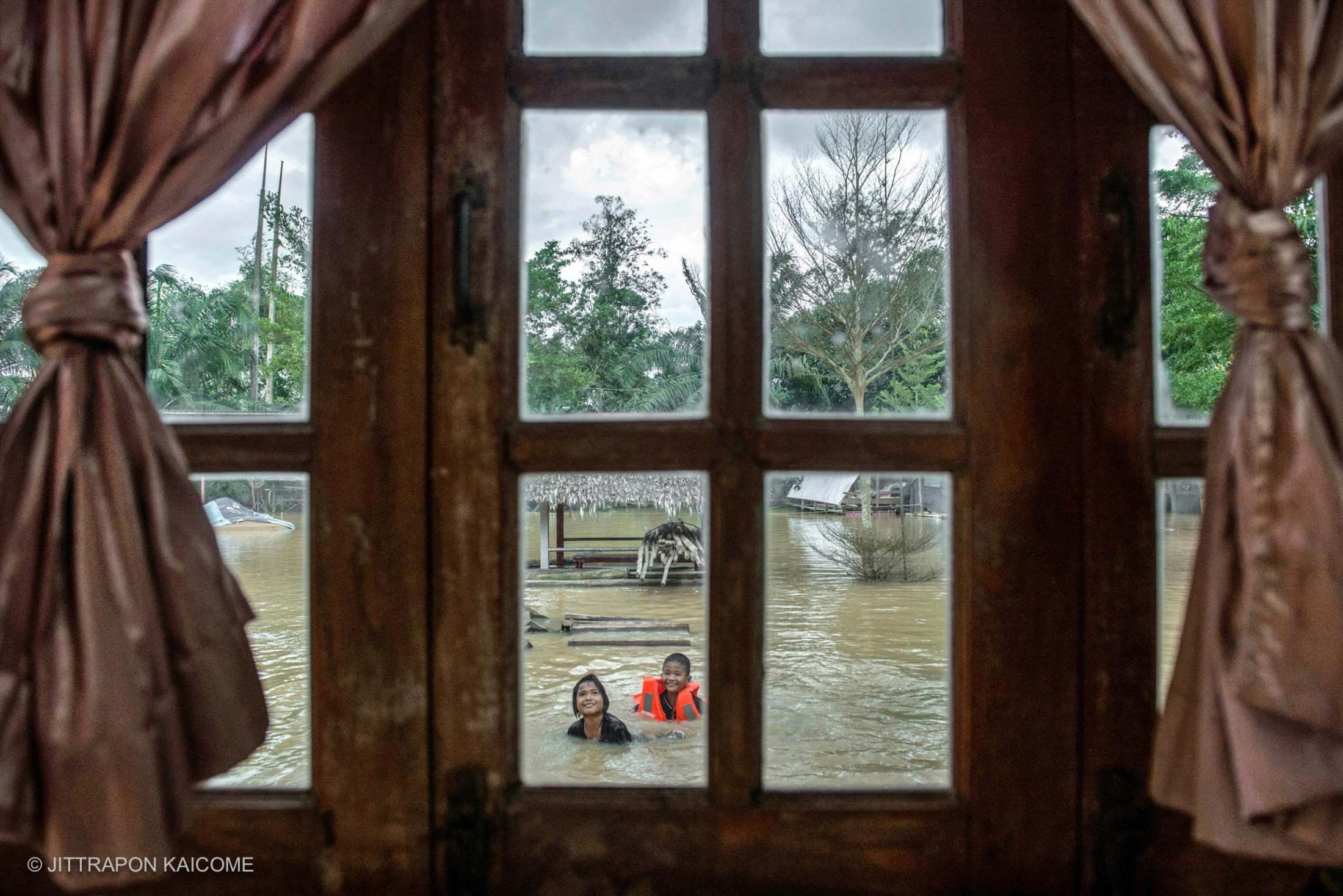 Southern Thailand is hit by Unusual flooding resulted in unseasonal rainfall more than 3 times in January, Civilians in Surat Thani is living with high rise flooding for many weeks. January 18, 2017.