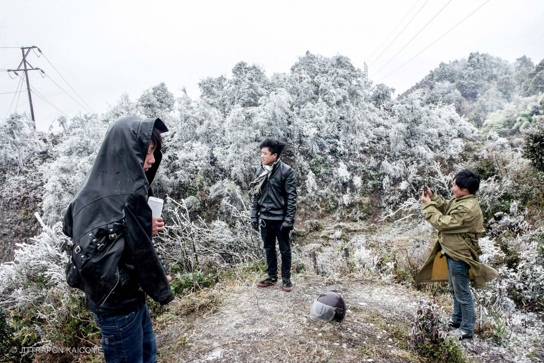 Northern Vietnam is experiencing the unusual cold wave that resulted in frost and snow on top of mountains. Local and foreign visitors are excited to come making traffic jams on mountain roads - Vietnam on February 05, 2018.