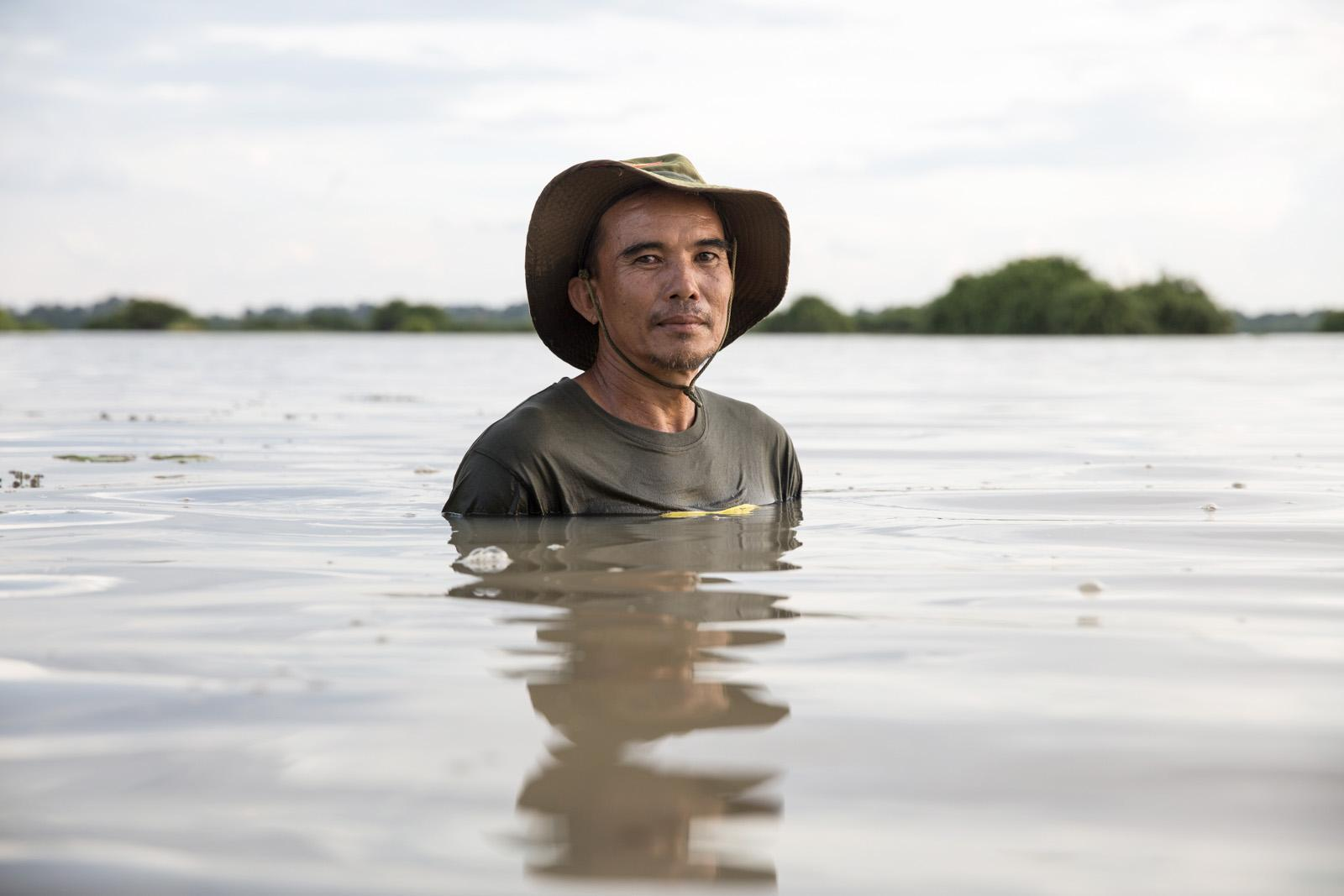 "Apirat Suthawan, 54, is the village chief of Lao Dong village. ""In 29 years the dam has not given us even the smallest bit of water to use!"" he said. He also saw how the village became split between those for the dam and against and how some of the disagreements still effect relationships today. June 2020"