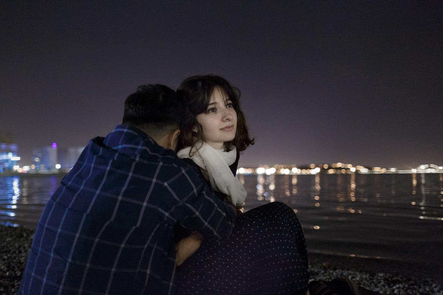 Yasamin (22) spends her evening with her boyfriend by an artificial lake in western Tehran. Almost a decade ago, relationships between unmarried women and men were a taboo among the majority of Iranians. Back then, couples could be arrested by the morality police for their relationship. Nowadays having a girl- or boyfriend is much more accepted in the Iranian society.