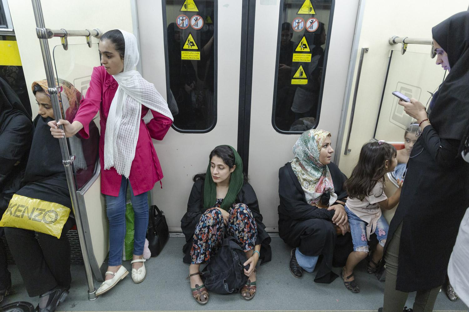 Reyhaneh (22) sits on the floor of the metro in Tehran after a long working day. An hour earlier she was asked by three different people to dress according to the Islamic guidelines within 50 meters.