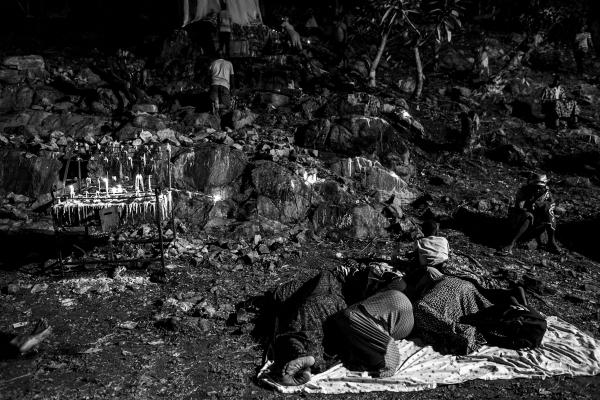 Pilgrims spend the night on the ground at the Our Lady of Lourdes grotto.