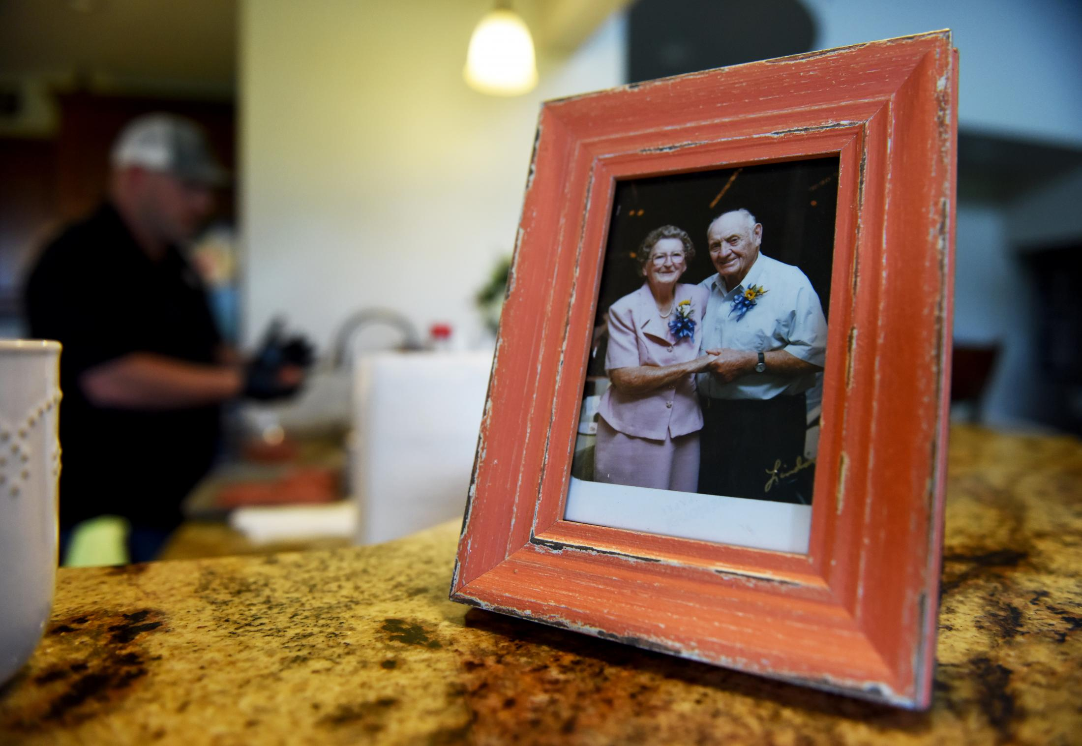 A picture of Fred Williams' grandparents, Roscoe Gibson and Mary Emma Gibson, sits framed in his kitchen on Thursday, May 21, 2020, in Clarksburg Missouri. His grandparents originally bought 640 acres of land in 1950 which has been kept in his family for the past 4 generations.