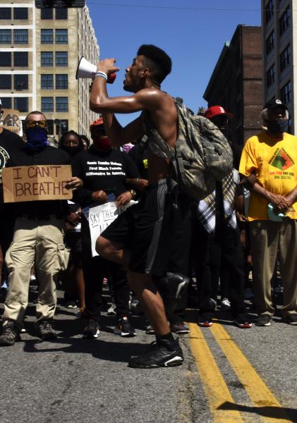 """Elijah Foggy, 19, leads chants at the Protest Against Police Murder on Sunday, June 7, 2020, on Washington Ave. in Downtown St Louis. """"My spirit [brought me here today], you know. I feel for my people, I feel their spirit."""""""
