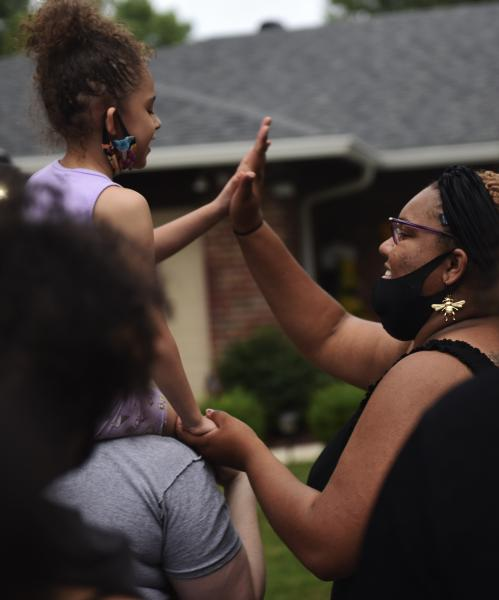 From left Nyra Hall, 5, high-fives Arkayla Tenney-Howard at a protest in front of Mayor Tim Lowery's home on Monday, June 8, 2020, in Florissant, Missouri.
