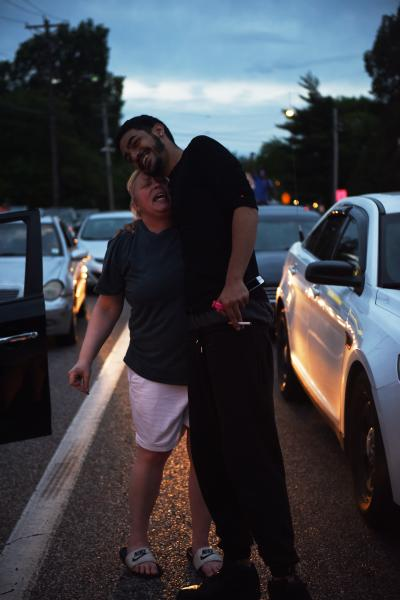 """A woman got out of her vehicle to join demonstrators blocking an intersection on Lindberg Blvd. in Florissant, Missouri, on Monday, June 8, 2020. """"I will stand with you,"""" she shouted as a protestor embraced her. """"Stay strong. Persist."""""""