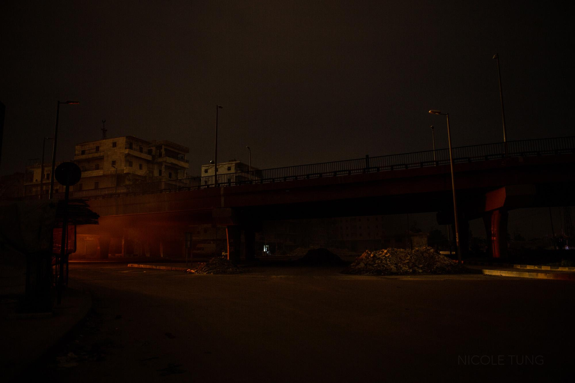 A bridge lit by car lights is seen in an opposition-held area, Aleppo, Syria. March 2013.