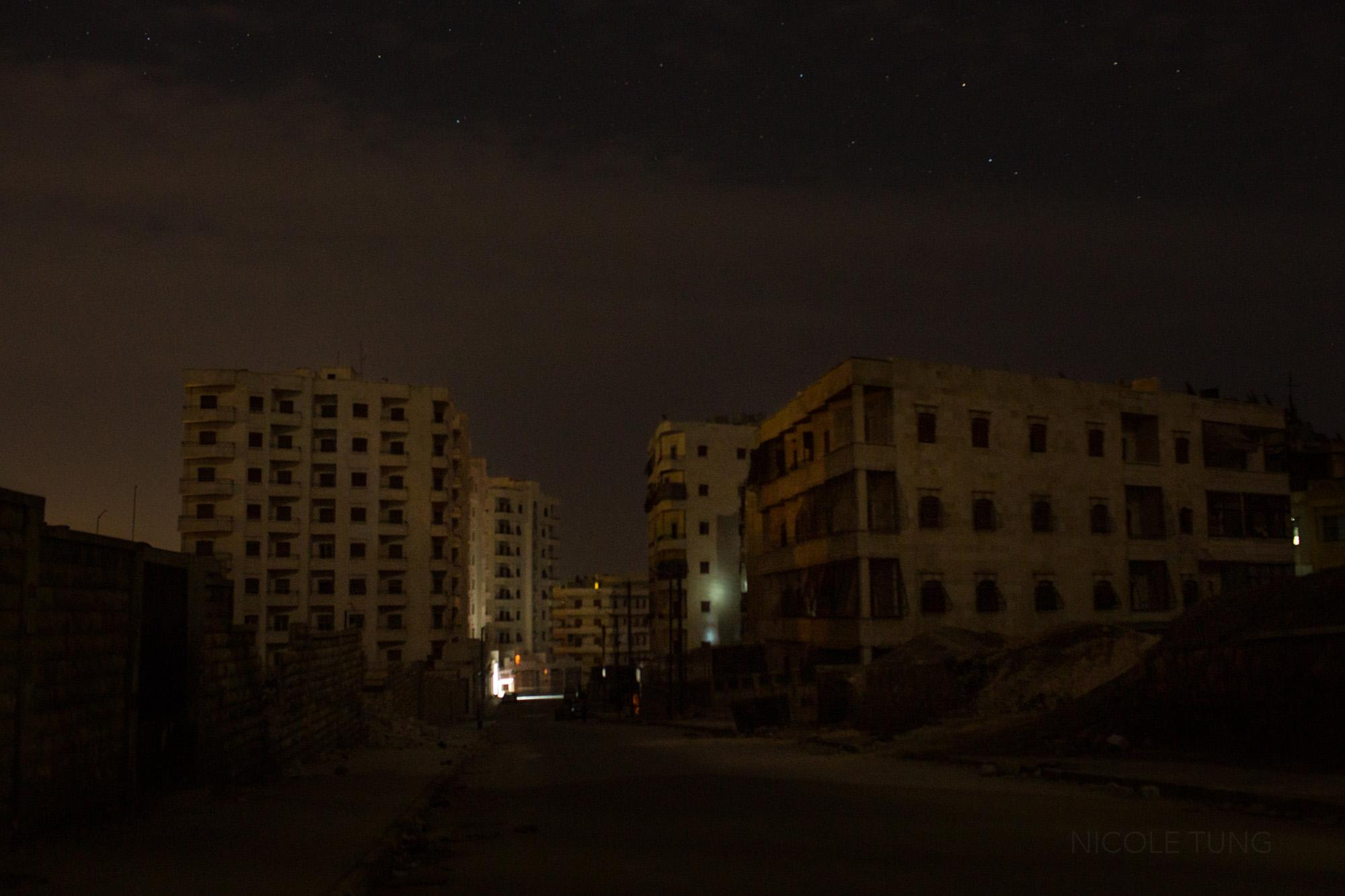 A view of apartment blocks without electricity in a neighborhood of Aleppo, Syria. March 2013.