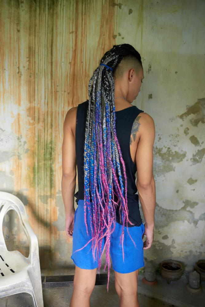 "CARACAS - AUGUST 7, 2019 Walcott, a 20-year-old hip hop dancer turned drag queen, in his home in Propatria, a barrio in West Caracas. Walcott's drag style is androgynous, using fantastical makeup with no padding, often shirtless. He uses this ""monster drag"" style to appeal to a wider audience and show that drag doesn't have to mean only dressing up as a woman. CREDIT: Lexi Parra"