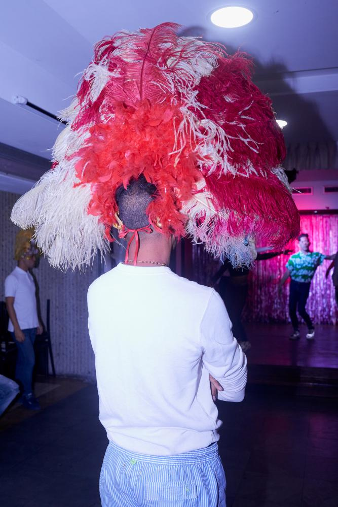 CARACAS - FEBRUARY 22, 2020. A drag performer looks on as a group of dancers rehearse for the night's show at the local club. CREDIT: Lexi Parra