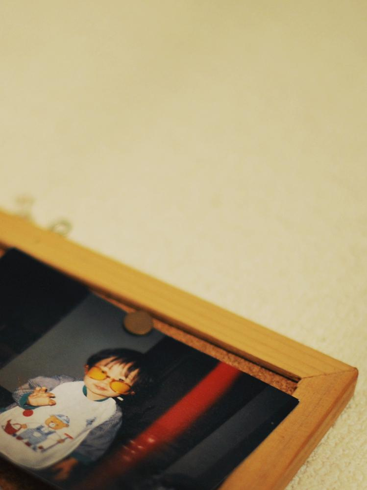 Picture of Rukiya Hara(12) who is 2 years old hanging on the living room wall.