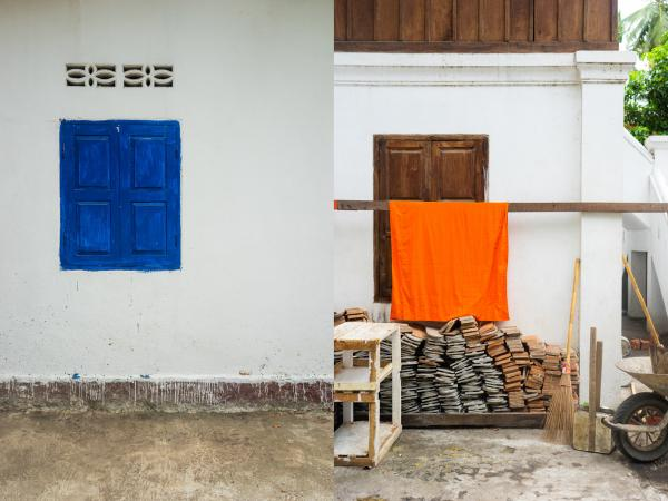 Luang Prabang, Laos  A blue window at a monastery. A Monks robes hangs outside to dry. The saffron (orange) robes monk wear dates back centuries. Orange was chosen mainly because of the dye available at the time. The tradition stuck and orange is now the color of choice for Theravada Buddhist followers in Southeast Asia, as opposed to a maroon color for Tibetan monks. The robes themselves are meant to symbolize simplicity and detachment of materialism.