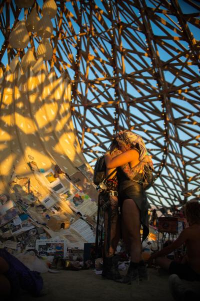 Black Rock City, Nevada, USA  Two people hug in the middle of the Temple at Burning Man. Since 1998, the event has been located at Black Rock City, a temporary city erected in the Black Rock Desert of northwestern Nevada. The temple is seen as a place of mourning for those whom have passed in the recent year.