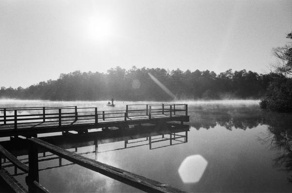 Perry, Mississippi, USA  A father and son fish in Lake Perry, in Perry county Mississippi. Shot on 35mm film on a Pentax ME Super.